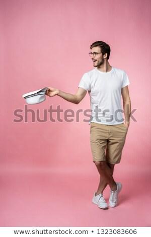 Heureux séduisant jeune homme chapeau Photo stock © deandrobot