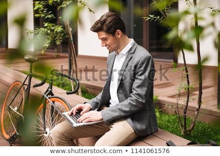 üzletember · lovaglás · bicikli · város · ázsiai · munka - stock fotó © rastudio