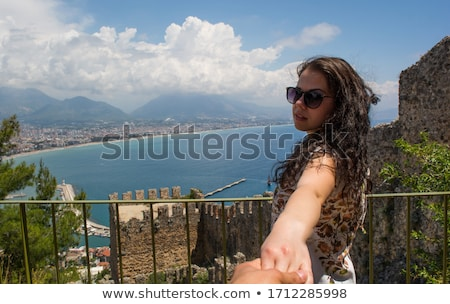 view from back of girl with her friend in sunglasses stock photo © deandrobot