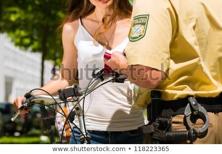 Kaukasisch politieagent fiets jonge paardrijden om Stockfoto © RAStudio