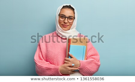 pretty woman holding spiral notebook over white stock photo © julenochek