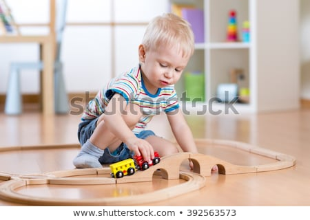 Stock photo: A boy playing with his toys