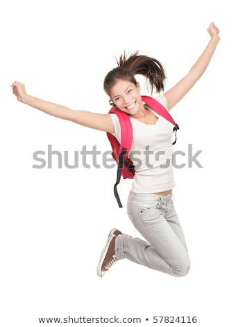Portrait of energetic fun girl student on a gray background in a Stock photo © Traimak