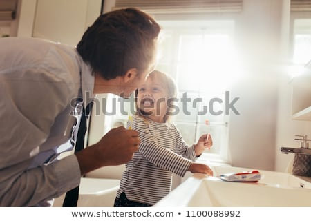 Man brushing his teeth in window Stock photo © IS2