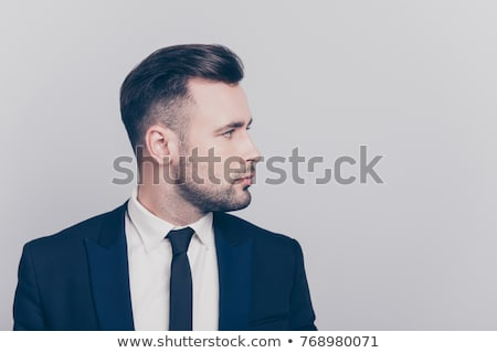 portrait of handsome young man in tuxedo looking to side Stock photo © feedough