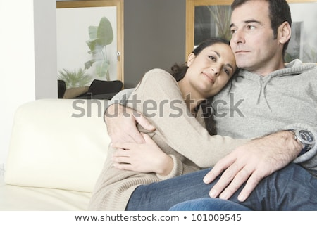 Hispanic Couple Holding Hands On Sofa at Home Stock photo © diego_cervo