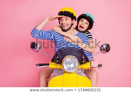 close up of male friends looking at motorbike stock photo © kzenon