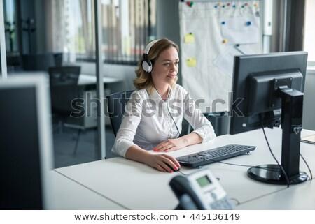 Gyönyörű fiatal lány fejhallgató iroda asztal portré Stock fotó © Traimak