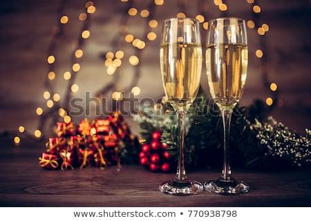 Dois óculos champanhe árvore de natal ramo festa Foto stock © Alex9500