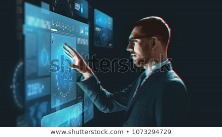 Zakenman virtueel scherm projectie business realiteit Stockfoto © dolgachov