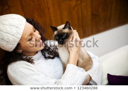 великолепный брюнетка любящий кошки привлекательный молодые Сток-фото © lithian