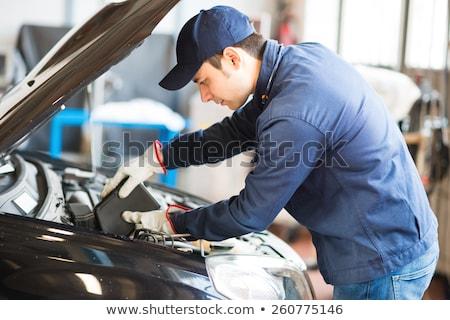 auto mechanic putting oil in a car engine stock photo © minervastock