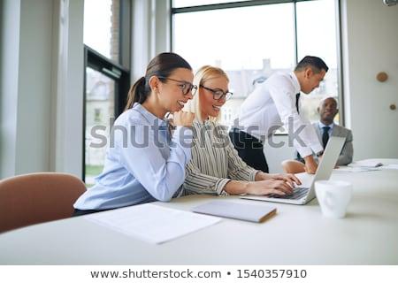 Gülen genç işkadını ofis mutlu çalışmak Stok fotoğraf © Minervastock