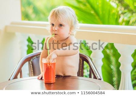 Boldog kisgyerek fiú iszik egészséges smoothie Stock fotó © galitskaya
