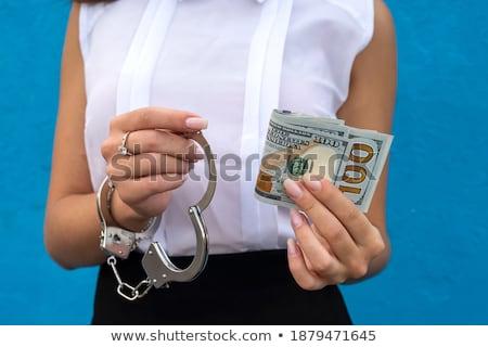 Kezek bilincs tart papír pénz fából készült Stock fotó © OleksandrO