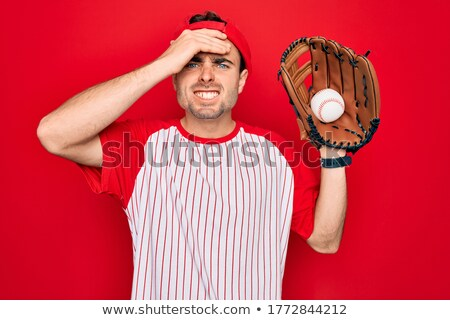 Young baseball play with glove on the head Stock photo © Lopolo
