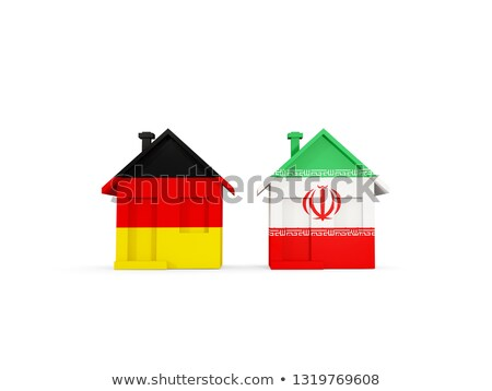 Two houses with flags of Germany and iran Stock photo © MikhailMishchenko