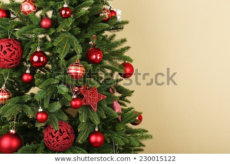 artificial christmas tree and presents at home Stock photo © dolgachov