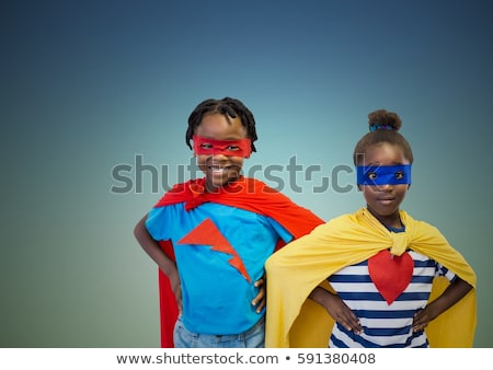 Portrait of boy in superhero costume against grey background Stock photo © Lopolo