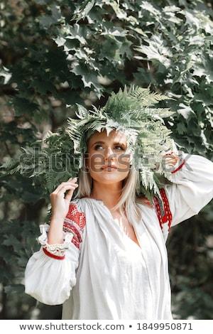 A young woman walks among the ferns Stock photo © galitskaya