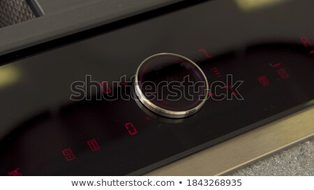 Close-up Of Girl's Hand Touching Electric Oven Stock photo © AndreyPopov