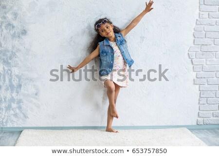 Beautiful young girl in denim waistcoat Stock photo © nyul