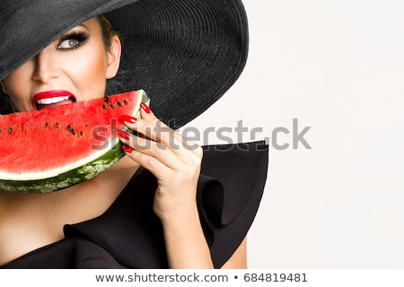 Beautiful blonde girl with red lips and manicured nails eating sushi, healthy japanese food. Beautif Stock photo © serdechny