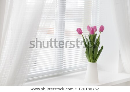 bouquet of pink tulips in a vase close up stock photo © elenabatkova