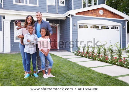 front view of happy african american parents with their children and boxes moving in new house stock photo © wavebreak_media