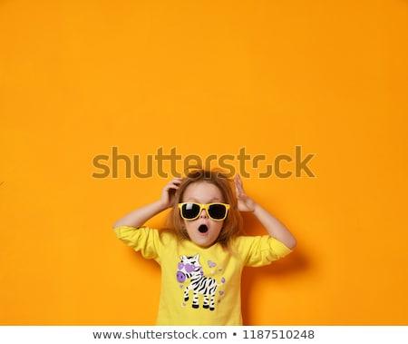 amazed teenage girl in yellow sunglasses Stock photo © dolgachov