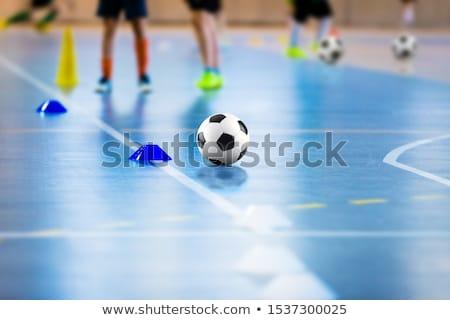 Futsal soccer training field. Young sports players with balls on training. Close up of futsal ball Stock photo © matimix