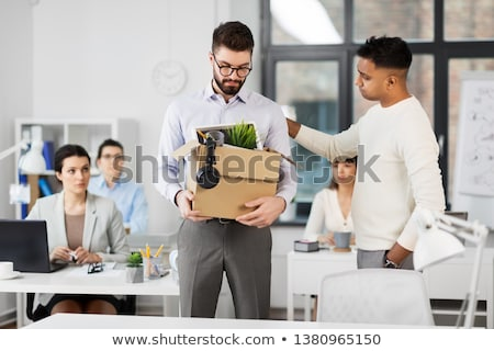 colleague seeing off sad fired male office worker Stock photo © dolgachov