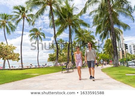 Couple walking on Waikiki beach Hawaii vacation. Happy couple in love relaxing at sunset on tourist  Stock photo © Maridav