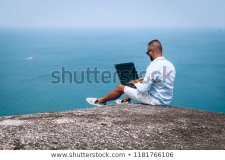 Homem laptop blue sky paisagem cabelo azul Foto stock © photography33