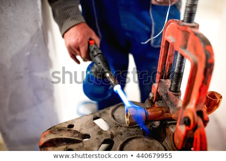 plumber with copper pipe and blowtorch stock photo © photography33