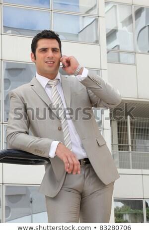 empresario · pie · fuera · oficina · mirando - foto stock © photography33