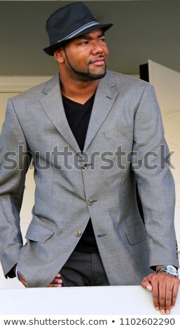 Zwarte man fedora aantrekkelijk knap afro-amerikaanse hoed Stockfoto © piedmontphoto