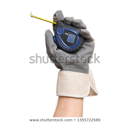 Construction worker holding a ruler Stock photo © photography33