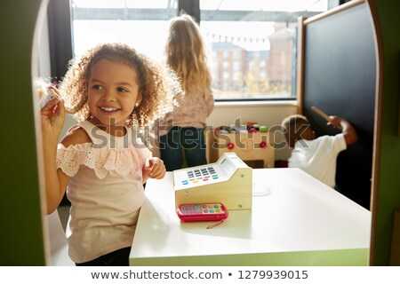 young girl playing with a toy till stock photo © photography33