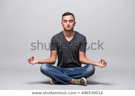 casual man sitting in lotus position stock photo © feedough