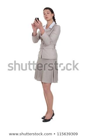 Morena mujer de negocios cuidadosamente escribiendo negocios Foto stock © photography33