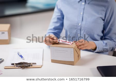 Woman with a box marked fragile Stock photo © photography33