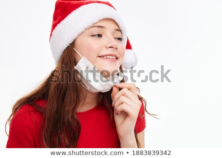 Funny red-haired girl in christmas cap with gift boxes. stock photo © Massonforstock