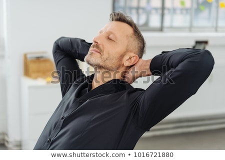 Man with his hands clasped behind his neck Stock photo © photography33