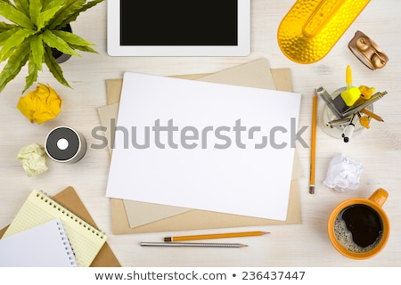 Desk concept with a blank paper and a modern tablet. Stock photo © maxmitzu