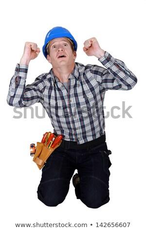 Stock photo: craftsman kneeling and thanking God
