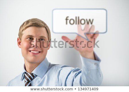 Handsome businessman pressing on follow button Stock photo © HASLOO