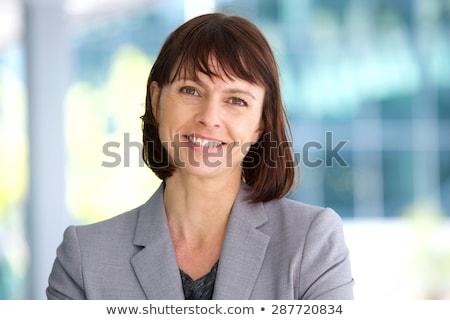 Beautiful white suit businesswoman portrait stock photo © lunamarina