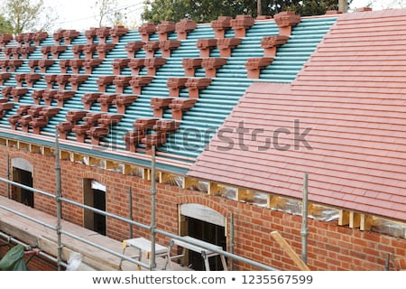 stacked roof tiles stock photo © rhamm