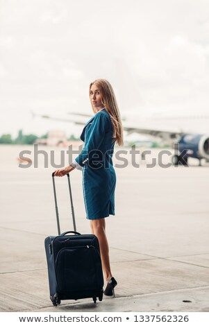 Young beautiful air hostess  with suitcase Stock photo © Aikon